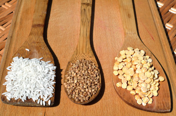 different grains on wooden spoons