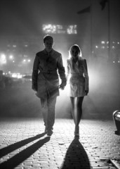 Black and white photo of couple silhouette at night