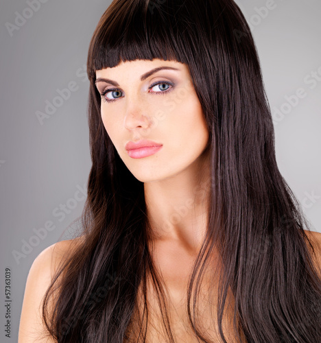 Portrait of a beautiful adult woman with long hair
