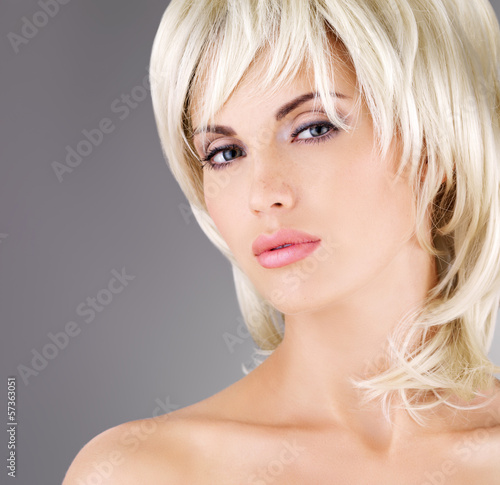 Beautiful woman with shot blond hairstyle