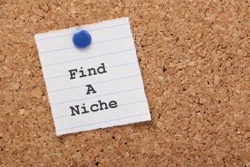 Find A Niche paper note on a cork notice board