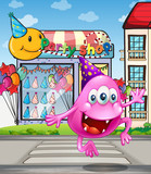 A happy beanie monster jumping in front of the party shop