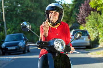 Senior woman showing the finger.
