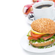 breakfast - burger with smoked salmon, vegetables and coffee