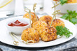 chicken meatballs in breading with tomato sauce on the plate