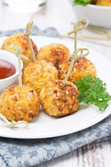 chicken meatballs in breading with tomato sauce, closeup