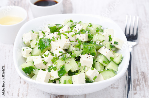 salad with cucumber, tofu, chives and sesame seeds