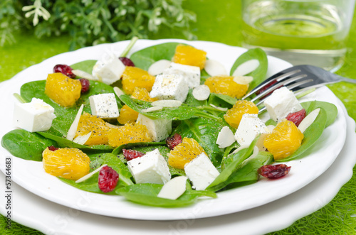 salad with spinach, feta and orange closeup horizontal
