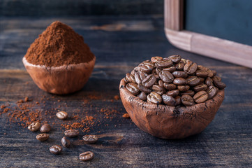 Bowl of coffee beans and ground coffee and menu board