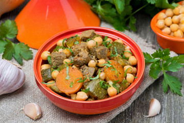 tagine with beef, chickpeas, vegetables and herbs, top view