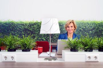 Confident Female Environmentalist In Office
