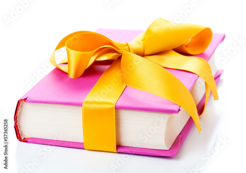 The book with a bow on a white background