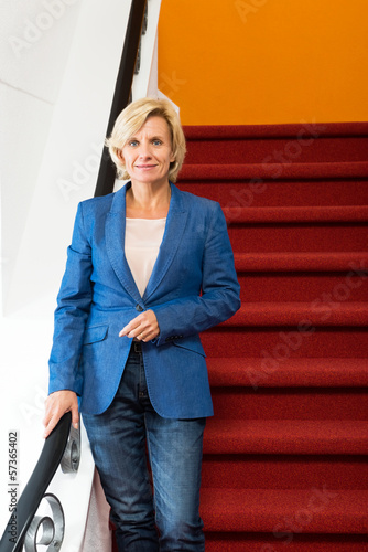 Confident Businesswoman Standing On Steps