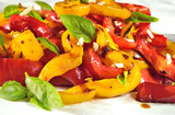 Rosted peppers salad closeup.Colorful vegan plate.