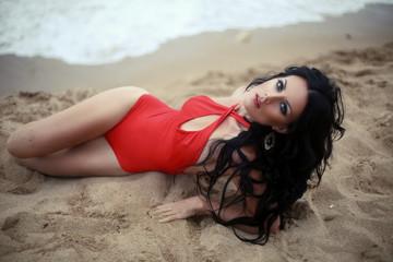 beautiful girl with dark hair on the beach
