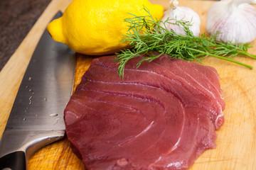 Raw tuna steaks on a cutting board