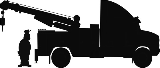 silhouette of driver with his tow truck