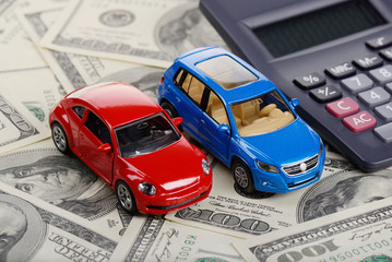 Calculator and car toys on the dollars