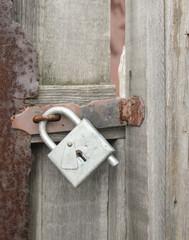 Wicket door with a padlock
