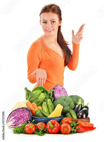 Young woman with assorted vegetables isolated on white