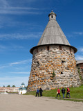 Pilgrims go by a tower of the Solovki monastery