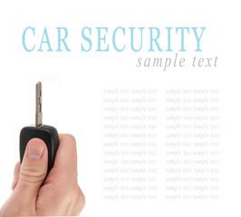 Hand holding car keys isolated on white background