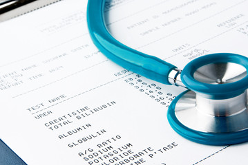 Blood test results in a clipboard with stethoscope