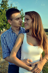 Beautiful young couple posing at the camera