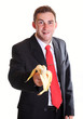 Business man offers a banana