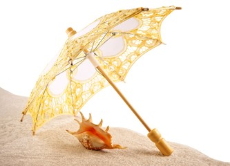 Shell under an umbrella on the sand, white background