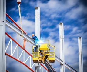 Workers welded steel structures