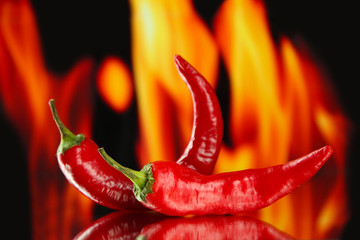 Red hot chili peppers on fire background