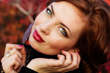Pretty woman in autumn park