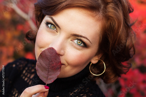 Pretty woman in autumn park