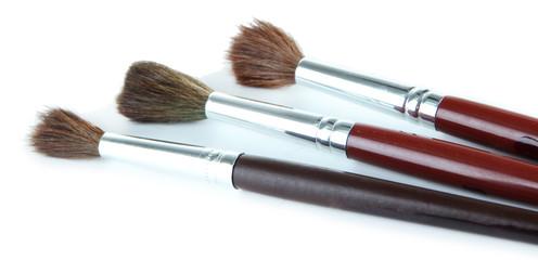 Three paint brushes isolated on white