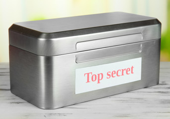 Confidential information in silvery box on bright background