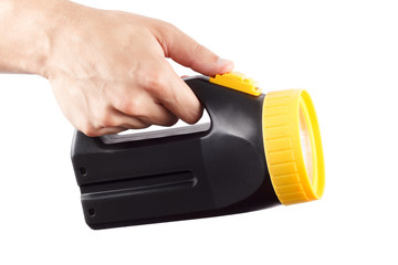 Hand holds black and yellow flashlight