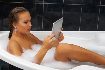 Girl with a digital tablet