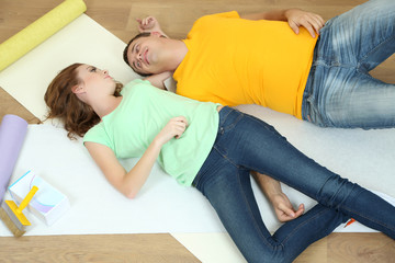 Young couple resting from renovation in new flat
