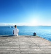 young man relax siting on pier