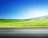 Fototapety asphalt road and perfect green field