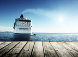 Caribbean sea and cruise ship and wood pier