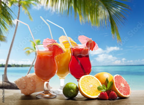 cocktails and tropical fruit on the beach