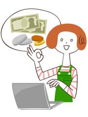 パソコンを使って家計簿をつける女性