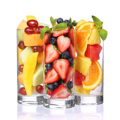 Fruit cocktails isolated. Fresh pieces of fruit in glasses