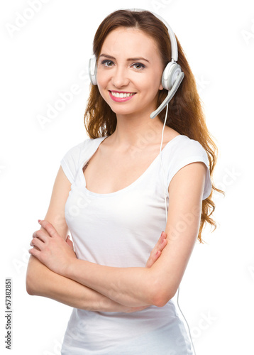 Lovely young woman is talking to customers