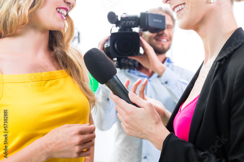 Reporter and cameraman shoot an interview