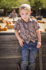 Little Boy With Hands in His Pockets at Pumpkin Patch.