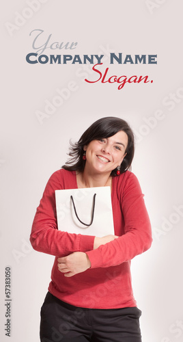 Happy brunette with shopping bag