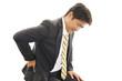腰痛のビジネスマン